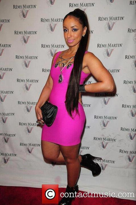 Mya rocking Glam Shop Online black reign boots and black bracelet!